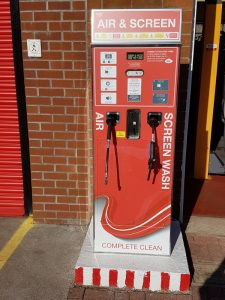 A red air and screen wash dispenser